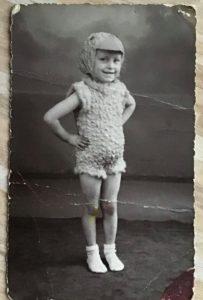 little child in chicken dance costume